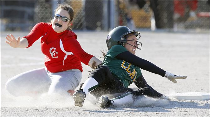 Clay's Danielle Holmes (2) is tagged out at second base by Centr