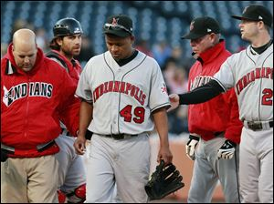 Indianapolis Indians pitcher Jose Ascanio (49) is helped off the field after being hit by a ball in the second game.