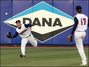 Toledo center fielder Andy Dirks (9) runs to catch a fly ball.