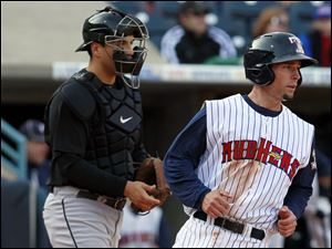 Toledo's Scott Sizemore (20) scores as Indianapolis catcher Jason Jaramillo (22) waits for the ball.