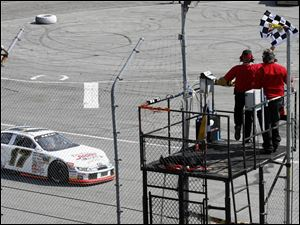 Driver Chris Buescher wins first place during the ARCA Racing Series at Toledo Speedway last September.