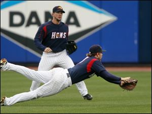 Toledo Mud Hens shortstop Cale Iorg dives but can't get a wind blown ball hit by Indianapolis' Josh Harrison during the fifth inning Wednesday morning of the Mud Hens' 4-2 loss at Fifth Third Field. The loss drops the Hens to 4-9 on the season.