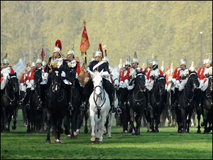 Cavalrymen of the Life Guards, part of the Household Cavalry Mounted Regiment, perform maneuvers for review.