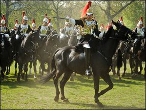 Cavalrymen of the Blues and Royals, part of the Household Cavalry Mounted Regiment, perform several maneuvers, including some that will be used at the Royal Wedding, before Major General Cubitt, who commands the Household Division. The review determines whether the Household Cavalry is fit to perform its ceremonial duties for the summer, including the royal wedding and the Trooping the Colour on the Queen's birthday.