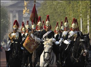 The Blues & Royals of the Household Cavalry Mounted Regiment ride along the Mall, backdropped by Buckingham Palace, in London on their way to Horse Guards Parade. The Blues & Royals together with the Life Guards will form a Sovereign's Escort for Queen Elizabeth II and a Captain's Escort for the bride and groom from Westminster Abbey to Buckingham Palace during the royal wedding of Prince William and Kate Middleton.