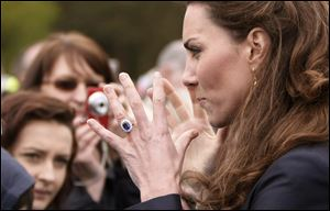 Kate Middleton talks with well-wishers in the crowd at Witton County Park, Darwen, England, when she and fiance Prince William visited local youth charities.