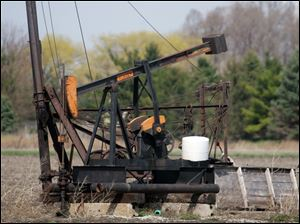 The oil pump jack on the property of Ivan Woodbury on Liberty Hi Road in Bowling Green is still in operation in 2011. Oil drilling began here in the early 1900s by Woodbury's grandfather, Alva Hartman.