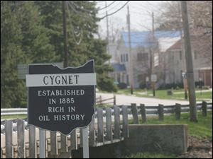 A sign on the outskirts of Cygnet, Ohio, notes the area is