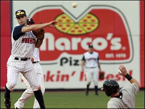 Toledo second baseman Scott Sizemore turns a double play on Louisville's Chris Valaika (3) during the seventh inning.