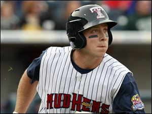 Toledo's Andy Dirks (9) watches his second home run of the game during the fourth inning against Louisville.