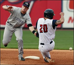 Toledo's Scott Sizemore steals second base against Louisville shortstop Zack Cozart (7) during the fourth inning.