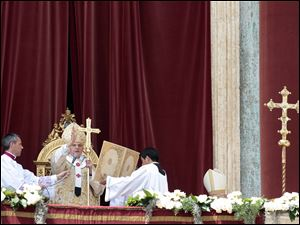 "Pope Benedict XVI, second from left, delivers his blessing during the ""Urbi et Orbi"" (Latin for to the City and to the World) message from the balcony of St. Peter's Basilica, at the end of the Easter Mass in St. Peter's Square."