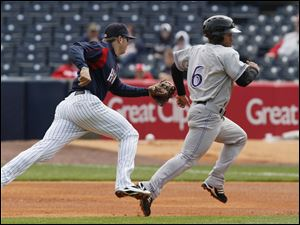 Mud Hens shortstop Cale Iorg races to plant a tag on Louisville baserunner Dave Sappelt, who was caught leading too far off first base. The Hens had a difficult time getting on track against the Bats pitcher Homer Bailey and were shut out for the second time this season.
