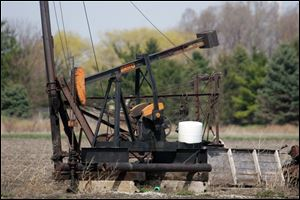 This oil pump jack near Bowling Green is still in operation and is within the Lima-Indiana Field, which stretches across Lucas, Wood, Hancock, Allen, and Van Wert counties in Ohio and into northeastern Indiana.