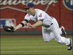 Cleveland Indians center fielder Grady Sizemore dives to catch a fly ball by Kansas City Royals' Melky Cabrera in the fifth inning Wednesday.