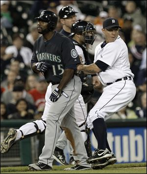 Detroit Tigers third baseman Brandon Inge, right, tags out Seattle