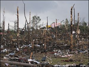Extensive damage is seen Wednesday after a tornado ripped through parts of Concord, Ala.
