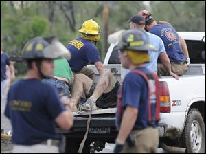 Rescue workers tend to an injured person in Concord, Ala., on Wednesday.