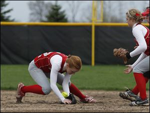 Bowling Green's Kara Maxey catches a ball that popped out of pitcher Casey Akenberger's (center) glove. At right is shortstop Becca Ruehl.