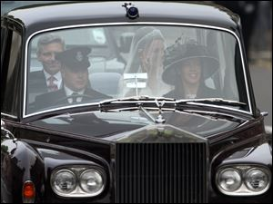 Kate Middleton, back right, makes her way to Westminster Abbey in a car with her father Michael Middleton bef