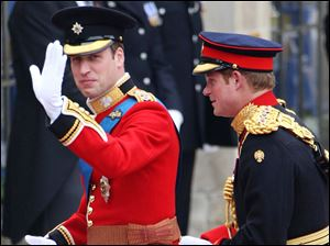 Britain's Prince William, left, arrives at Westminster Abbey accompanied by his brother Prince Harry.
