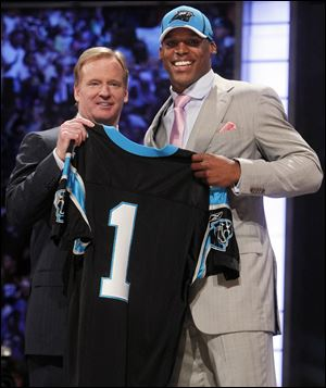 Cam Newton holds a jersey with NFL commissioner Roger Goodell after being taken with the No. 1 pick in the draft by Carolina. The Heisman Trophy winner led Auburn to the national championship.