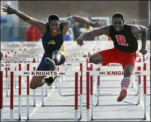 Below, DerJuan Gambrell, right, edges Whitmer's Mark Meyers to win the 110 hurdles with a time of 14.61.