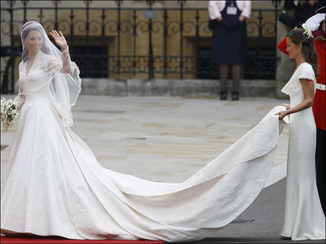 mcqueen royal dress Kate Middleton is accompanied by maid of honor Pippa Middleton, right, as she arrives at Westminster Abbey.