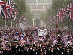 Spectators make their way down the Mall to Buckingham Palace after the royal wedding for Britain's Prince William and his wife Catherine, Duchess of Cambridge.