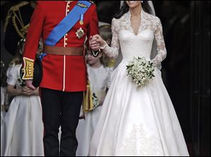 The royal couple exit Westminster Abbey after their wedding.