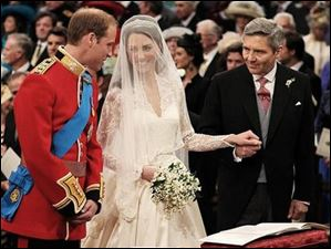 Prince William greets Kate Middleton as she arrives at the altar with her father Michael Middleton.