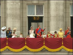 Britain's Prince William, center right, stands on the balcony of Buckingham Palace with his wife, Catherine, Duchess of Cambridge, and other members of the royal family and their wedding party, in this image taken from video.
