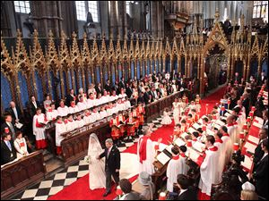 Kate Middleton is led by her father Michael Middleton down the aisle at Westminster Abbey.
