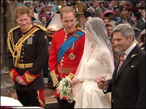 Britain's Prince William, second left, greets his bride, Kate Middleton, with father Michael Middleton holding her hand, as his best man and brother, Prince Harry, looks on at the altar at Westminster Abbey.