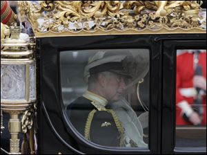 Britain's Prince Charles and Camilla, Duchess of Cornwall, ride in a carriage to Buckingham Palace after the royal wedding of Prince William and Kate Middleton.