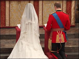 Kate Middleton and Britain's Prince William kneel at the altar during their wedding service at Westminster Abbey.