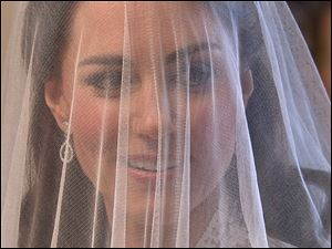 Kate Middleton's face is covered by her veil before she reaches the altar at Westminster Abbey, in this image taken from video.