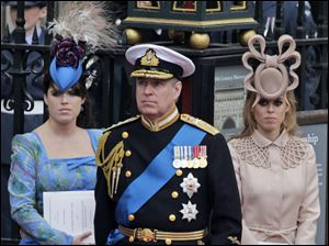 Britain's Prince Andrew, center, and his daughters, Princess Eugenie, left, and Princess Beatrice attended the royal wedding, but ex-wife Sarah Ferguson was not invited.