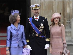 Spain's Prince Felipe is flanked by Princess Letizia, right, and Spain's Queen Sofia, left, outside of Westminster Abbey at the royal wedding for Britain's Prince William and Kate Middleton.