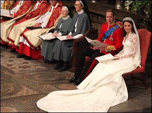 Britain's Prince William and Kate Middleton listen to the sermon during their wedding service.