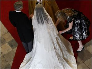 Kate Middleton has her dress adjusted prior to walking down the aisle at Westminster Abbey.