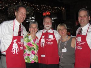 From left, Tom Antonini, Terri Zmuda, Bill Bingle, Cathy Trimble, and John Thebes at St. Francis de Sales High School Waite-Knight.