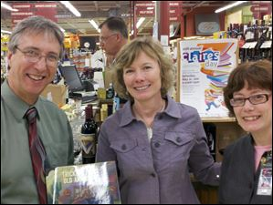 Dominic Catalano, Julie Rubini, and Mary Chwialkowski attend a wine-tasting to benefit the Library Legacy Foundation of the Toledo Lucas County Public Library and Claire's Day Inc.