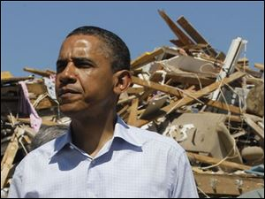 President Obama visits tornado damage in the Alberta neighborhood in Tuscaloosa, Ala., on Friday.