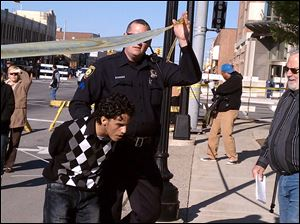A man is arrested by police at a free-speech rally by Rev. Terry Jones in Dearborn, Mich. Other protesters gathered to demonstrate against Mr. Jones.