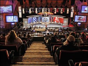 Fans look on during the fourth round of the NFL football draft by the at Radio City Music Hall Saturday in New York.