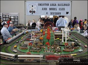A display set up by the Swanton Model Railroad Club is a big draw at the Amtrak station near downtown Toledo for National Train Day. An Amtrak passenger train was available for tours.