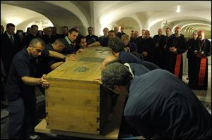 The coffin of late Pope John Paul II is prepared for transfer from the crypts below St. Peter's Basilica.