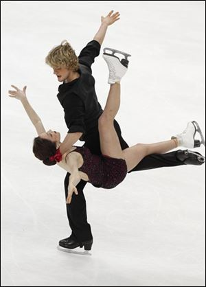 Meryl Davis and Charlie White of the United States wrap up the gold in ice dancing.