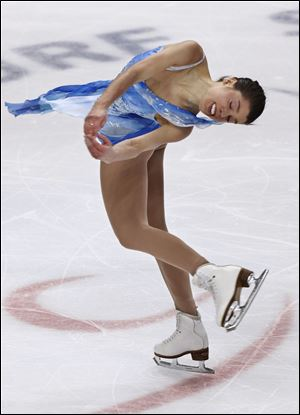 Alissa Czisny of Bowling Green competes in Saturday's free skate portion of the world figure skating championship. Czisny, who is the U.S. champion, came into the night in fourth place, but her fifth-place finish in the free skate dropped her one spot.